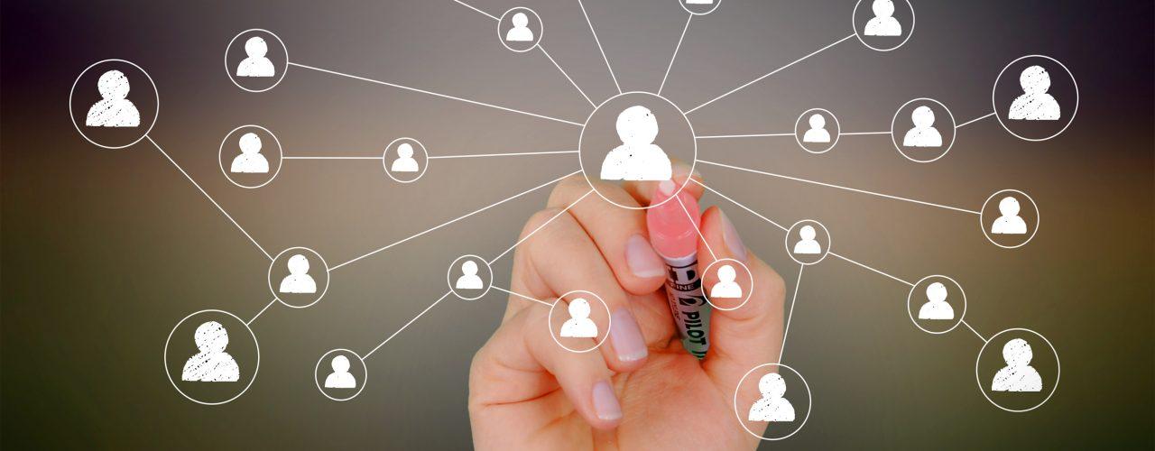 Businessman drawing a social network on virtual screen